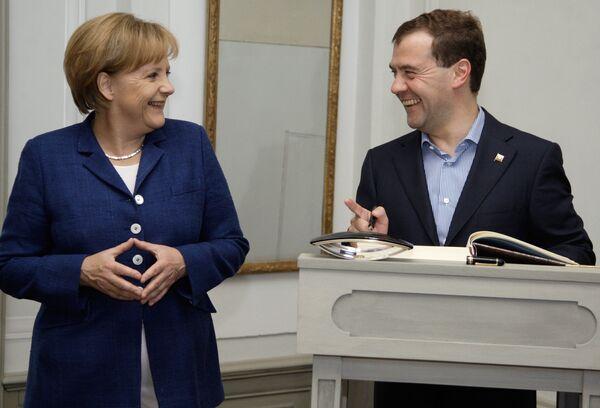 German Chancellor Angela Merkel and Russian President Dmitry Medvedev. Archive - Sputnik International