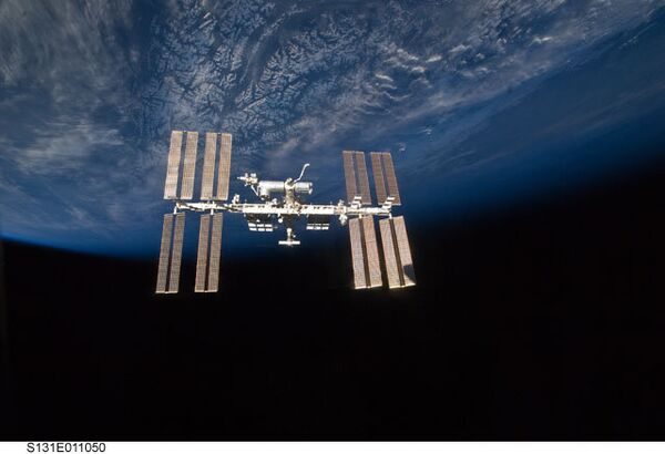 Corrections to the space station's orbit are conducted periodically before launches of Russian cargo ships and U.S. shuttles to compensate for Earth's gravity and to safeguard successful dockings. - Sputnik International