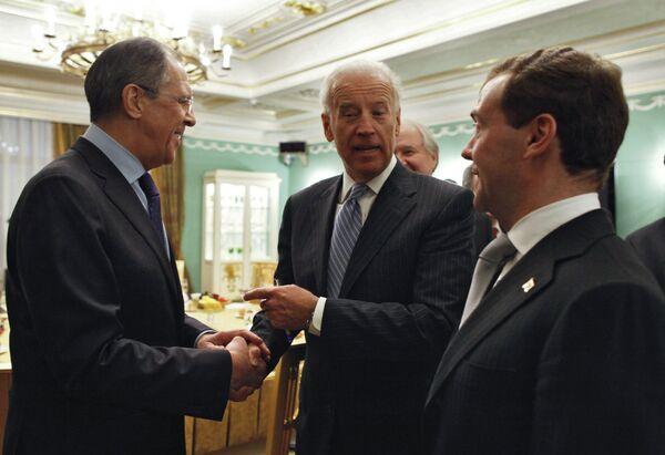 Sergei Lavrov, Joe Biden and Dmitry Medvedev - Sputnik International