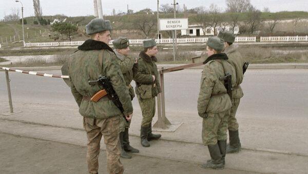 Soldiers of the Russian peacekeeping force patrolling a motor road. Archive  - Sputnik International