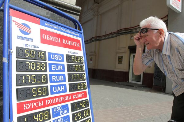 Belarus' central bank has devalued the ruble to 4,930 per dollar from 3,155, while the government has applied for a $1 billion loan from Russia and a $2 billion loan from EurAsEC. - Sputnik International