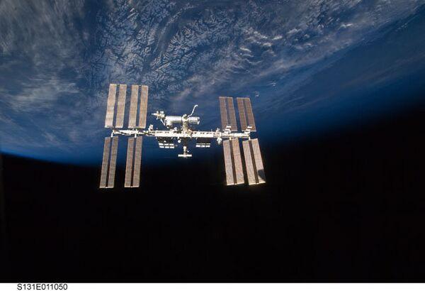 The Soyuz TMA-04M spacecraft docked at ISS - Sputnik International