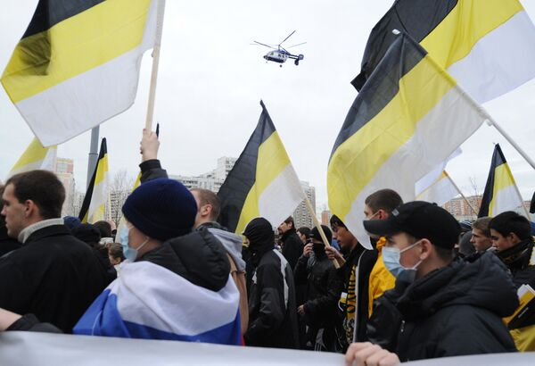 Nationalists' flags of black, yellow and white colours - Sputnik International