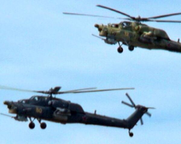 The Golden Eagles demonstrate formation flying. A Mi-28N cab video  - Sputnik International