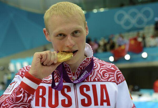 Ilya Zakharov of Russia took diving gold in the men's three-meter springboard - Sputnik International