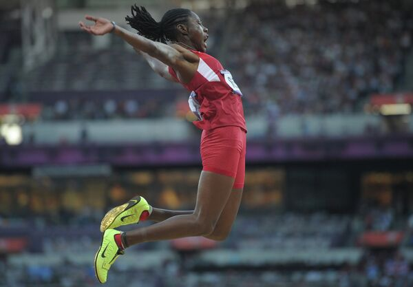 Brittney Reese leaped 7.12 meters to win Olympic gold in the women's long jump - Sputnik International