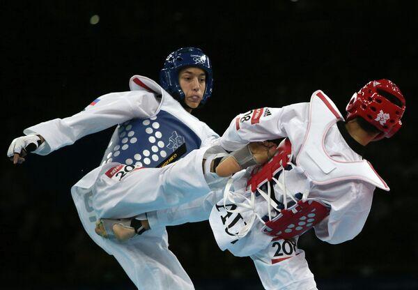 Alexei Denisenko scored a narrow win over Australia's Safwan Khalil to claim Olympic bronze for Russia - Sputnik International
