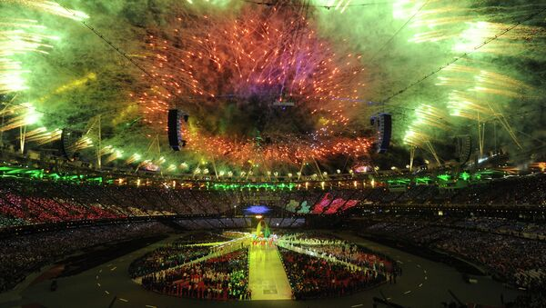 Final fireworks lighten the Olympic stadium during the closing ceremony of the 2012 London Olympic Games on August 12, 2012 - Sputnik International