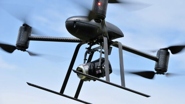 Draganflyer X6, a remotely operated, unmanned, miniature helicopter designed to carry wireless video cameras and still cameras - Sputnik International