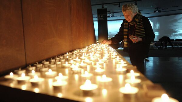 Ceremony of candle lightening in the Holocaust victims memorial. - Sputnik International