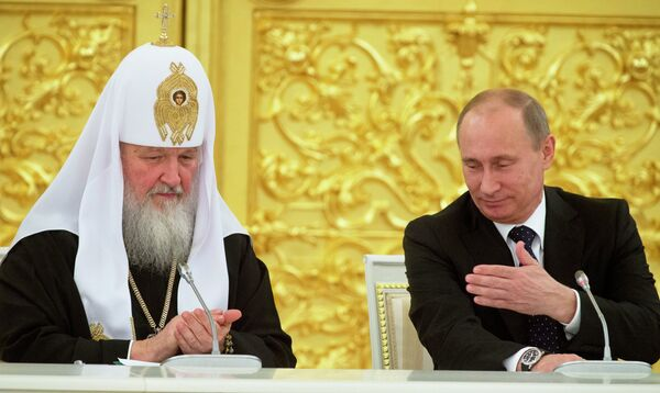 The Patriarch of Moscow and All Russia Kirill and Vladimir Putin - Sputnik International