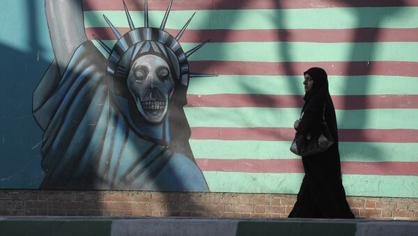 A woman walking past the outer wall of the former US embassy in Tehran, which was seized by Islamists in 1980 - Sputnik International