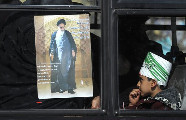 A city bus navigating traffic in Tehran earlier this month, adorned with an image of Ayatollah Khomeini. - Sputnik International