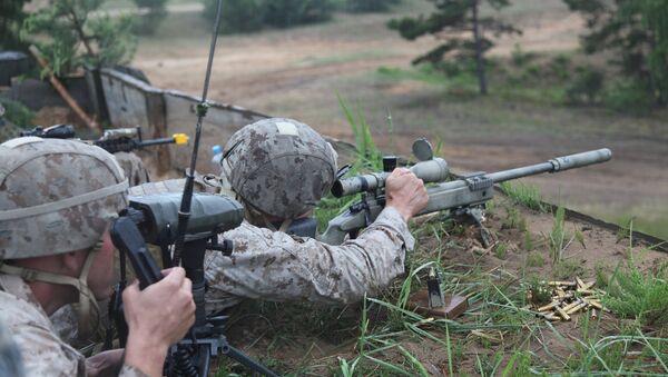 A US Marine takes aim at a long range target at the live fire range on Base Camp Adazi, Latvia on June 15, 2012 - Sputnik International