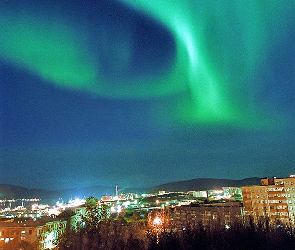 The Northern Lights are a by-product of a space storm. Here, they light up the skies over Murmansk, Russia. - Sputnik International