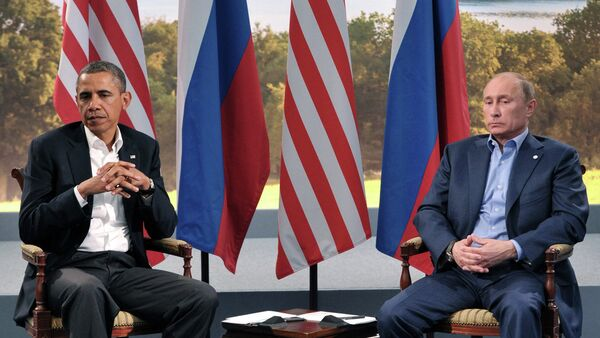 US President Barack Obama meets with Russian President Vladimir Putin during the G8 Summit in Northern Ireland on June 17. They will be seen together again at the G20 Summit in Russia on Thursday. - Sputnik International