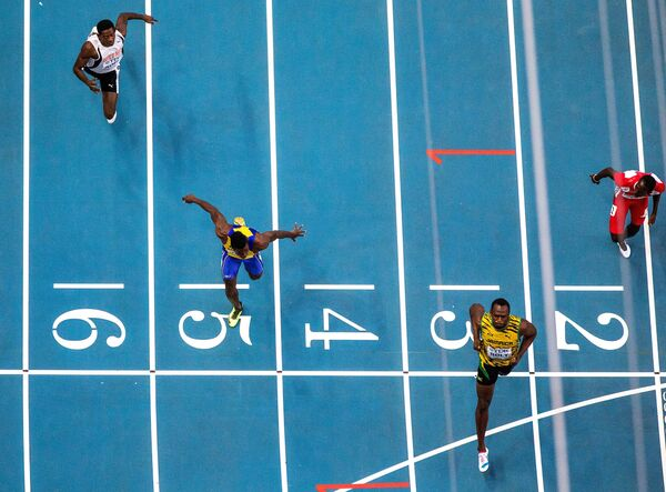 Bolt Charges to World 100m Gold in Moscow - Sputnik International