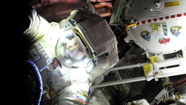 "Russian cosmonaut Alexander Misurkin conducts a check of his spacesuit, ""Orlan-MK,"" before his Friday spacewalk. - Sputnik International"