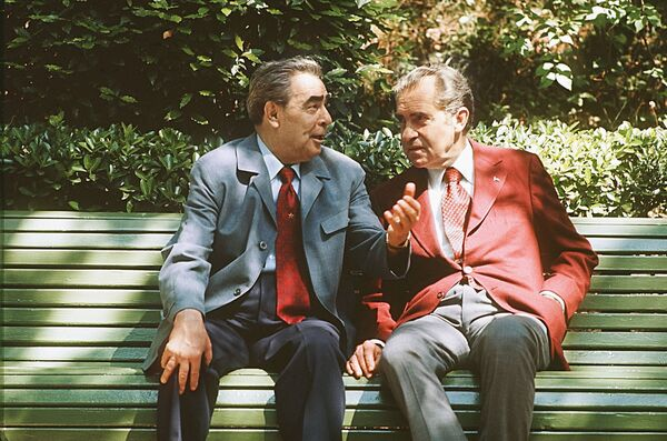 Former Soviet leader Leonid Brezhnev and former US President Richard Nixon chat on a bench in Crimea in 1974. - Sputnik International