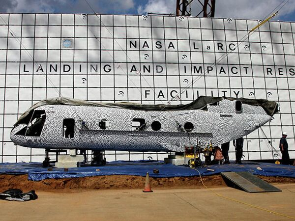 The former Marine helicopter's fuselage was painted in black polka dots as part of a high-speed photo technique. - Sputnik International
