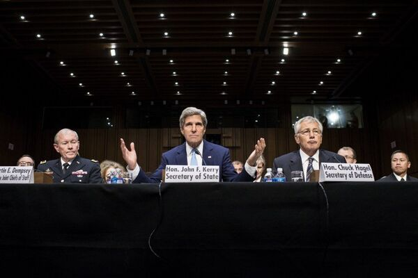 US Chairman of the Joint Chiefs of Staff Martin E. Dempsey (L) and US Secretary of Defense Chuck Hagel (R) listen to US Secretary of State John Kerry speak during a hearing on Syria at the Senate in Washington Tuesday. - Sputnik International