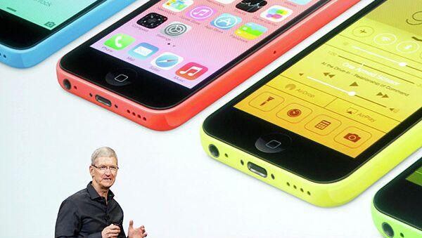 Apple CEO Tim Cook talks about the colorful new iPhones in Cupertino, California, Tuesday. - Sputnik International