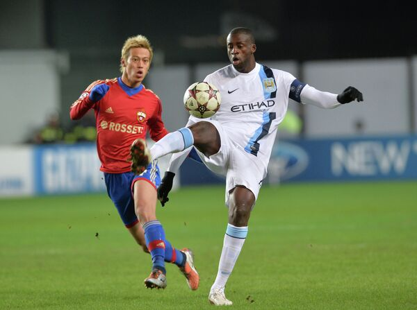 CSKA Moscow's Keisuke Honda and Manchester City's Yaya Toure during the Champions League match at Arena Khimki, Moscow, October 23, 2013 - Sputnik International