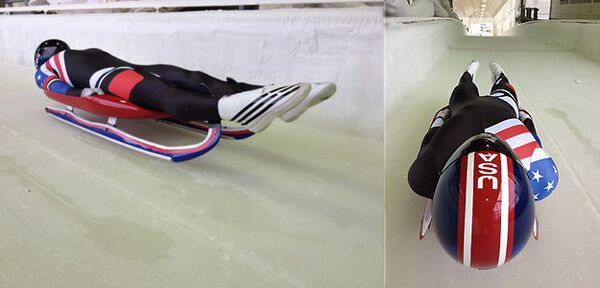 The new USA Luge design has a sleek black racing suit with American flag symbols on the right shoulder and side. - Sputnik International