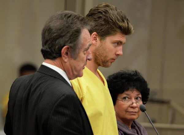 Colorado Avalanche goalie Semyon Varlamov, standing between his attorney Jack Rotole, left, and a Russian interpreter, appears in court in Denver on Thursday, Oct. 31, 2013 - Sputnik International