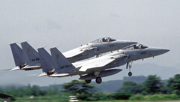 Two F-15J Eagle aircraft of the 202nd Tactical Fighter Squadron, Japanese Air Self Defense Force (JASDF), take off in formation during the joint U.S./Japan exercise Cope North 85-4. - Sputnik International