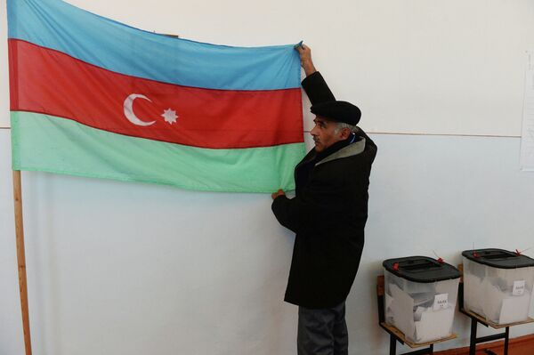 Election Monitoring and Democracy Studies Center was critical of October elections that secured a third term in power for Ilham Aliyev - Sputnik International