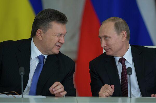 Viktor Yanukoyvch and Vladimir Putin - Sputnik International