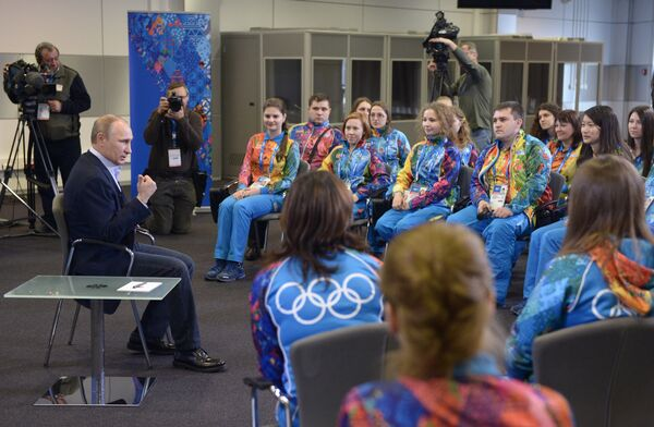 Vladimir Putin at a meeting with Olympic volunteers in the mountain village of Krasnaya Polyana - Sputnik International