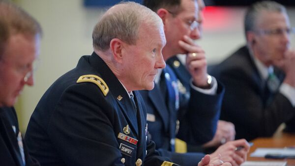 US Army Gen. Martin E. Dempsey, chairman of the Joint Chiefs of Staff, speaks with his Russian counterpart Gen. Valery Gerasimov during a NATO meeting for defense chiefs in Brussels, January 21, 2014 - Sputnik International
