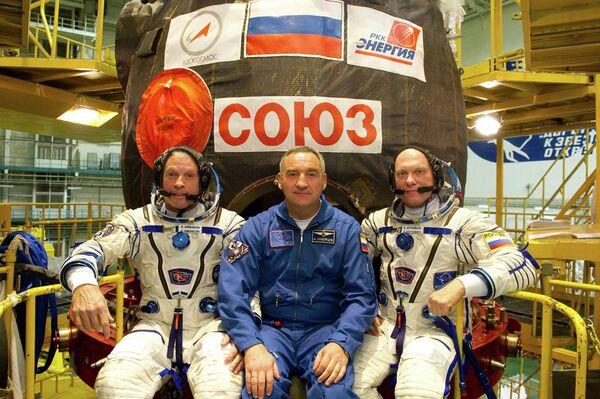 Steven Swanson, Alexander Skvortsov and Oleg Artemyev - Sputnik International