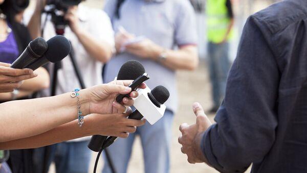 Journalists during an interview - Sputnik International