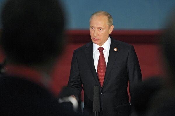 May 21, 2014. President Vladimir Putin talks to Russian journalists in Shanghai - Sputnik International