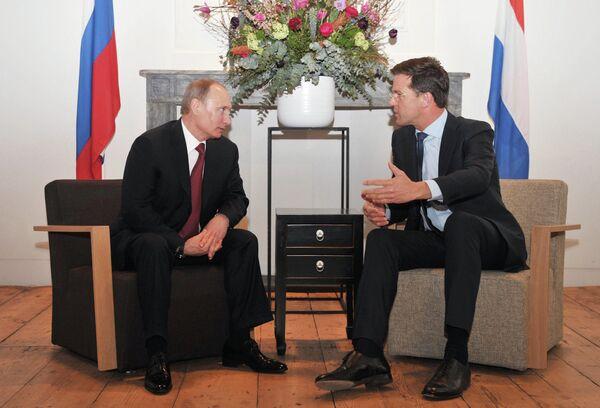 Russian President Vladimir Putin and Dutch Prime Minister Mark Rutte - Sputnik International