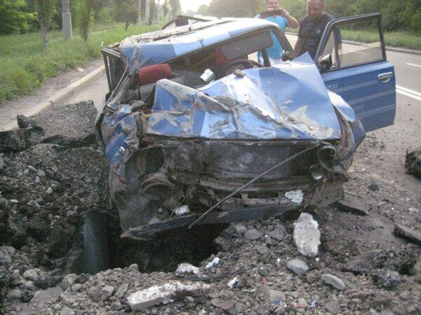 Car shelled in Donetsk - Sputnik International