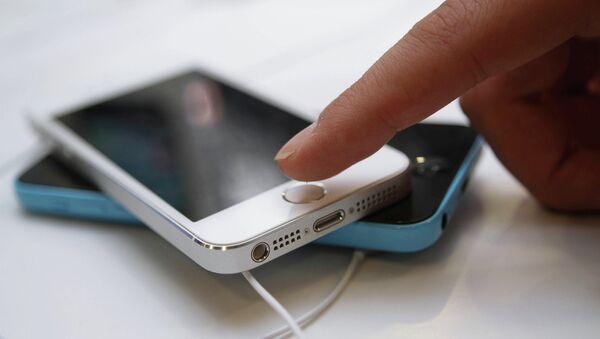 Официальный старт продажи iPhone 5s и iPhone 5c в Москве - Sputnik International