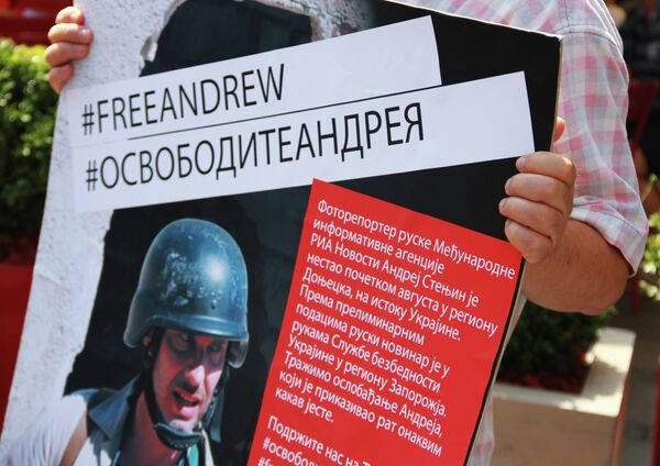 A campaign in support of Russia's photo correspondent Andrei Stenin, who went missing in eastern Ukraine - Sputnik International