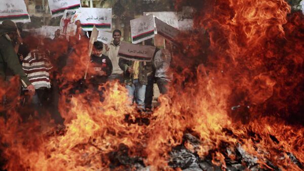 Benghazi residents burn portraits of Muammar Gaddafi - Sputnik International
