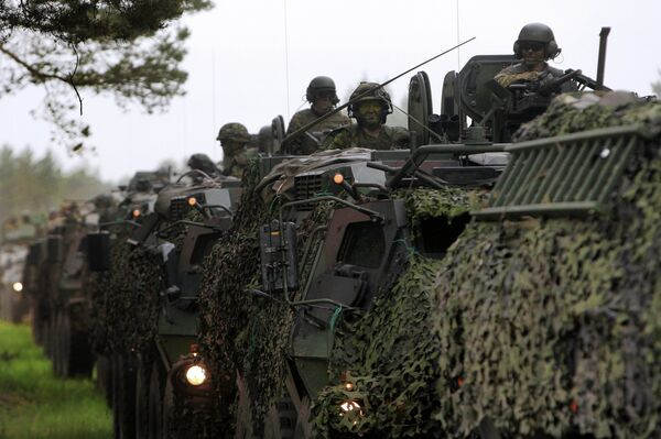 US, Estonian, Latvian, Lithuanian, and British soldiers during a joint military drills in Latvia, June 10, 2013. - Sputnik International