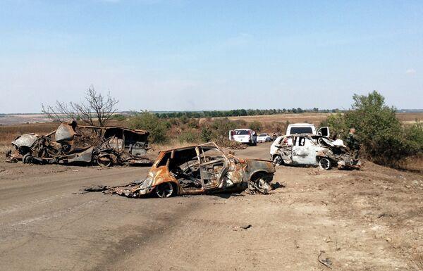 Burned out cars at the death site of  Rossiya Segodnya photojournalist Andrei Stenin, who was killed near Donetsk. - Sputnik International