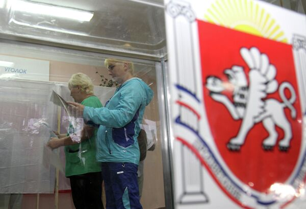 Residents of Simferopol, capital of Crimea, vote in its first ever parliamentary election since the reunification with Russia. - Sputnik International