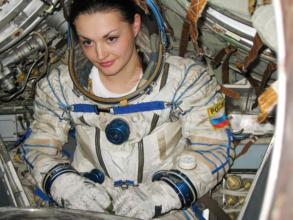 Yelena Serova, was launched into Earth orbit on Thursday night aboard Soyuz TMA-14M spacecraft - Sputnik International