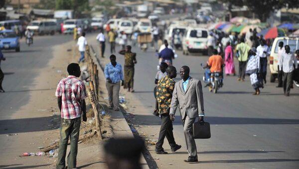 People walk on a street in Juba, southern Sudan, - Sputnik International