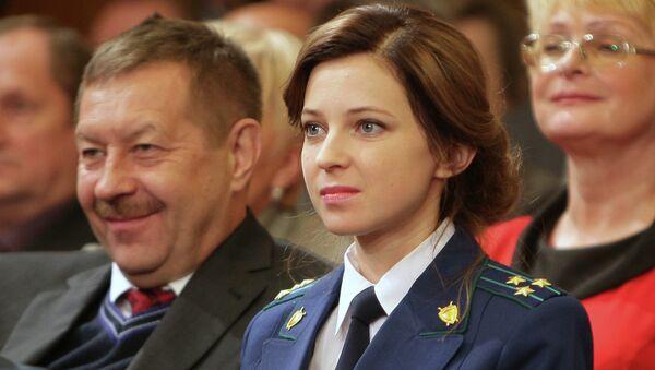 Crimean Prosecutor General Natalya Poklonskaya (center) has revealed that Kiev's hostility to her appointment last March included death threats and threats of jail time. - Sputnik International