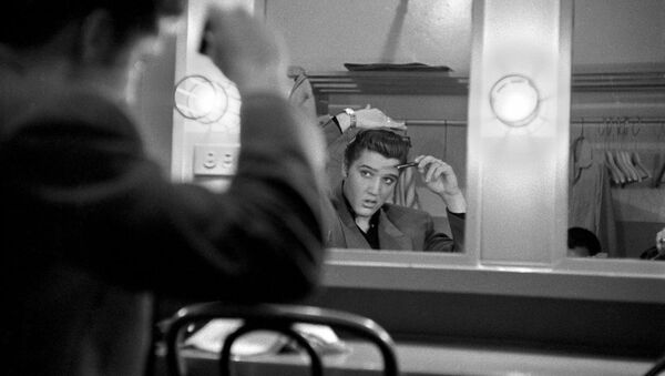 March 17, 1956. Backstage at the Dorsey Brothers 'Stage Show' rehearsal. One of the first Alfred Wertheimer's pictures of Elvis. - Sputnik International