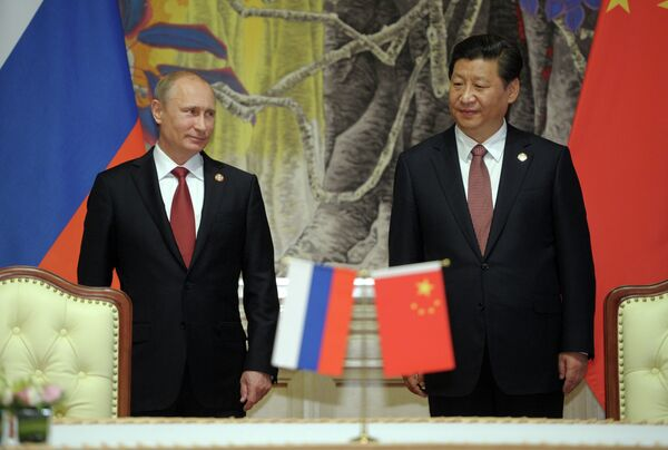Russian President Vladimir Putin's visit to China in May 2014 marked the beginning of several major investment projects and the launch of a number of cooperation agreements between the two countries. - Sputnik International